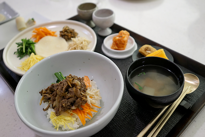 Platter of seven delicacies and bibimbap made at the Korean Cuisine Culture Center