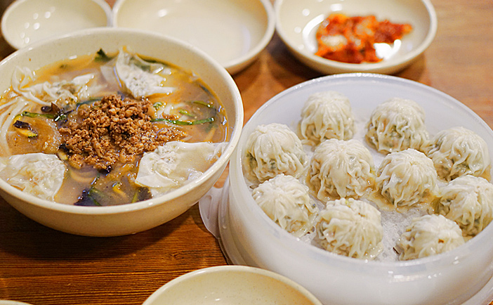 Signature dumpling and the exterior of Myeongdong Kyoja