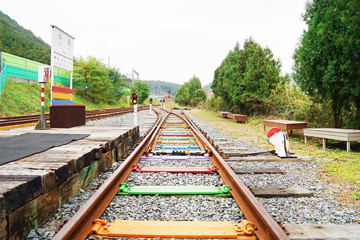 Colorful railroad tracks of Jeonju Hanok Railbike and old-school cafe
