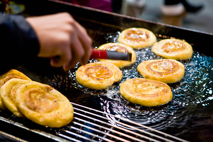 Photo: Deep-fried hotteok (Korean stulye of hot sweet pancake)