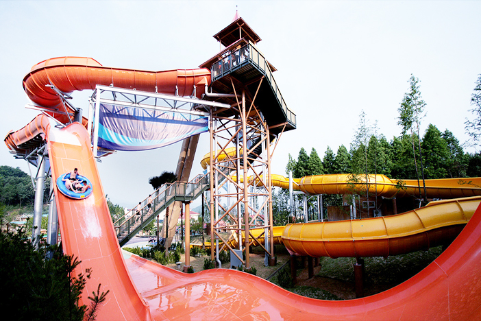 amusement-park-slide-asian-teen
