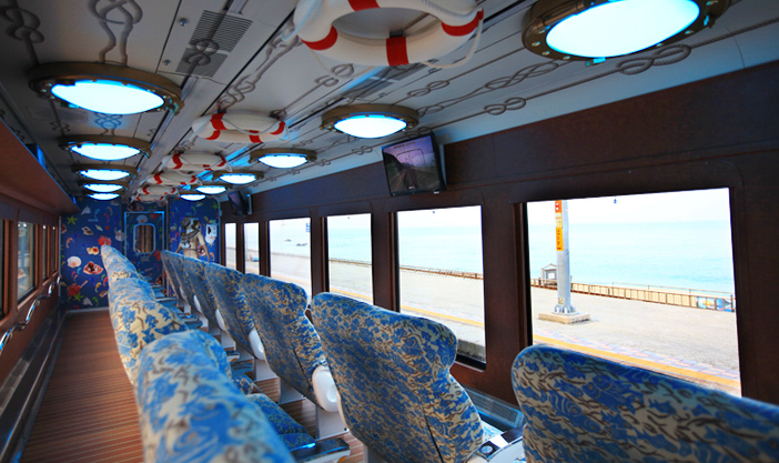Exterior of Sea train dynamically decorated with dolphins