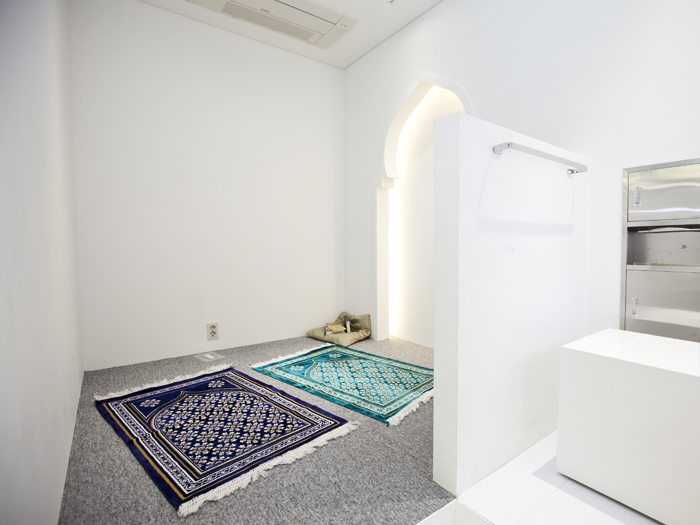Separate prayer rooms for males and females with footbath facilities.