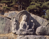 Rock-carved Buddha Triad 