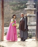 Buddhist Monk and Woman 