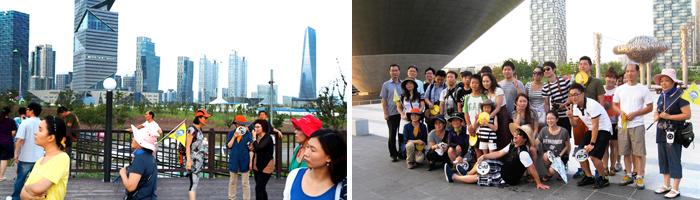 Tourists walking on the bike path, travelers take a group souvenir photo on the bike path