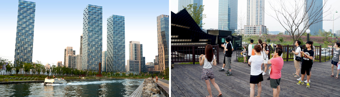 Songdo future building along the road around the lake and blend appearance, those who watch the future road