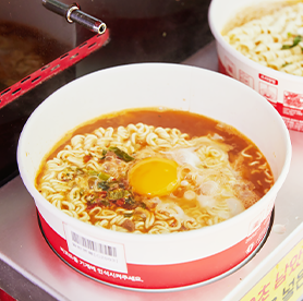 A classic convenience store ramyeon at Hangang Park after a bike ride.