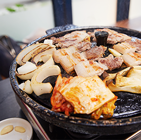 The perfect combination you won't forget – grilled kimchi and samgyeopsal