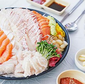 Hoe en un mercado de pescado y sopa maeuntang